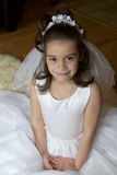 Communion Girl. Portrait of a little girl in communion dress and veil Stock Photography