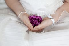 Free Communion Girl Dressed In White With A Purple Flower In Her Handas Stock Photos - 110925303
