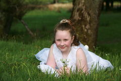 Communion Girl. This is a photograph of a young girl about 7 years of age, it's her first Holy Communion and it is a big day for her Stock Photos