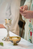 Communion Host. The holy bread of the communion during the mass Royalty Free Stock Images