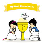 Communion. My first communion card. Boy and girl praying together with a calyx Stock Images