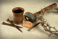Communion Nails and Crown of Thorns. Communion elements with crown of thorns and nails over vintage cloth Stock Photos