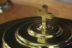 Communion Plate Cross. The cross on top of the communion plate cover Stock Photos