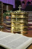 Communion Plates and Bible. The Communion Plates ready to go with a bible spread out in front of them Stock Photo