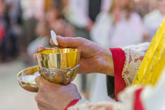 Communion Rite. Holy bread rite during the Catholic Mass Stock Image