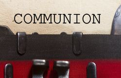 Communion typed on an old vintage paper. With od typewriter font Stock Photography