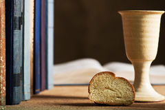 Communion under both kinds. Still life with chalice of wine and bible Royalty Free Stock Photos