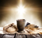 Communion - Unleavened Bread With Chalice Of Wine. And Cross Light royalty free stock image