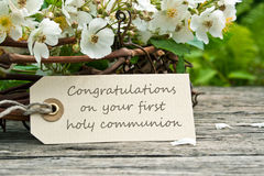 Communion. White roses with card to  communion Royalty Free Stock Photos