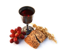Communion. Wine, bread and grapes isolated on white Stock Photo