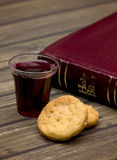 The Communion. On a wooden background stock photos