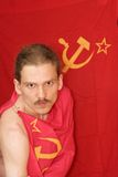 Communist. Man in attitude of combat dressed in USSR flag Royalty Free Stock Photography