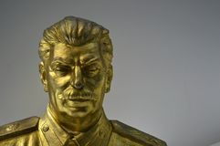 Communist artefacts - Gold Stalin statue - Museum Prague stock images
