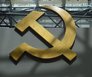 Communist artefacts - Soviet hammer and sickle - Museum Prague. Communist artefacts - Hammer and sickle and red star on soviet propaganda flag - Museum Prague stock images