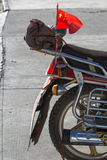 Communist flag at the backside of a bike. The road of Friendship in Tibet - Going to Kathmandu stock image