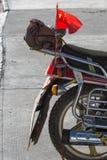 Communist flag at the backside of a bike Stock Image