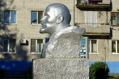 Communist historical symbol Vladimir Ilich Lenin, Khabarovsk region Russia, 4.08.2018. Statue Of Lenin With Apartment Blocks In Background royalty free stock photo