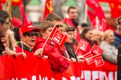 Communist party supporters take part in a May Day rally Stock Photo