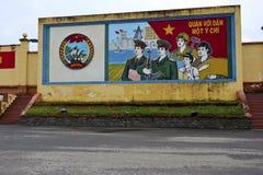 Communist propaganda mural in danang vietnam. A large communist propaganda mural painted on a wall in danang vietnam royalty free stock photos