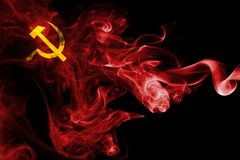 Communist smoke flag. Isolated on a black background Stock Photos