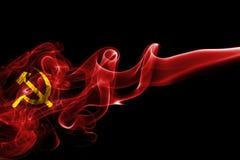 Communist smoke flag. Isolated on a black background Stock Image
