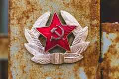 Communist Soviet Badge. Rusty Metal royalty free stock photography