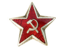 Communist star. Old communist star with sickle and hammer isolated on a white background Royalty Free Stock Photos