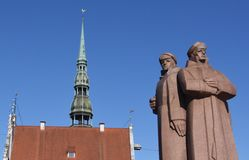 Communist statue and church spire Stock Photography