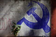 Communist wall in Kerala. A Communist symbol painted in blue on a wall at Varkala, in the Communist State of Kerala, India Royalty Free Stock Photo