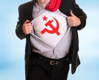 Communist. Young angry businessman tearing his shirt communist symbol hammer and sicke on it Royalty Free Stock Images