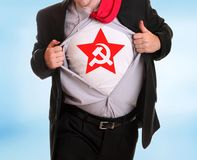 Communist. Young angry businessman tearing his shirt communist symbol hammer and sicke on it Royalty Free Stock Photography