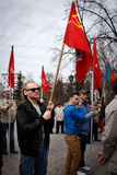 Communists party in a May Day. Man holding flag USSR in a May Day Stock Photography