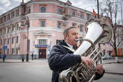 Communists party in a May Day. The Man is playing on the tuba in the parade of the Communist Party Royalty Free Stock Images