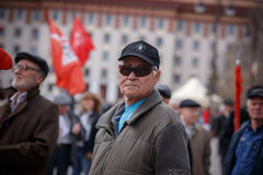 Communists party in a May Day. Old man in a May Day Stock Photos