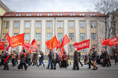 Communists party in a May Day. Peoples go to communists party with banners and flags Royalty Free Stock Photography