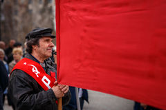 Communists party in a May Day. Single man holding a banner on communists party Stock Photo