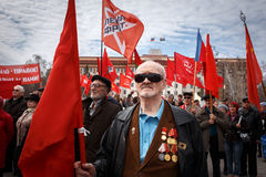 Communists party in a May Day. Veteran of WWII on communists party with  flags Stock Photos