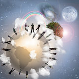 Community. Of people encircle the earth Royalty Free Stock Photography