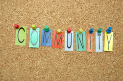 Community. Word Community  placed from colourful small letters on the cork board Royalty Free Stock Image