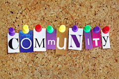 Community. Concept letters attached to a cork noticeboard with thumbtacks stock photos