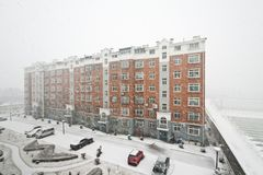 Community building in snowing Stock Photos