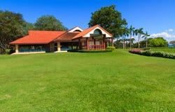 Community center. On grass field stock photos