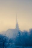 Community church on a foggy morning. Royalty Free Stock Photo