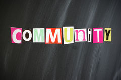 COMMUNITY. Colorful COMMUNITY letters on Chalkboard royalty free stock photos