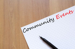 Community Events concept. White blank notepad on office wooden table Community Events concept stock photography