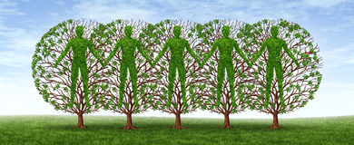 Community And Friendship. Concept with a group of trees in the shape of people holding hands together in harmony as a growing partnership in a strong Royalty Free Stock Photography
