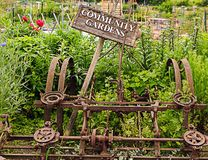 Community Garden; old farm equipment Stock Photography