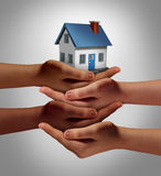 Community Housing. Concept and neighbor support or neighborhood watch symbol as a connected group of diverse hands supporting and holding a family home as a stock illustration