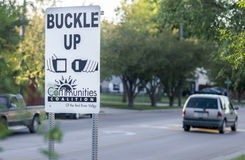 Community Initiated Buckle Up Sign in Neighborhood. Moorhead, Minnesota, United States - July 21, 2015: Buckle up road sign by a suburban neighborhood, promoted stock photo
