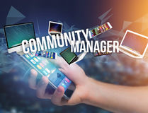 Community manager title surounded by device like smartphone, tab Royalty Free Stock Photos